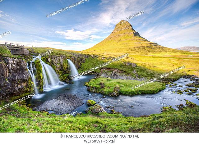 Kirkjufell Mountain, Snaefellsnes peninsula, Iceland. Landscape with waterfalls, long exposure in a sunny day