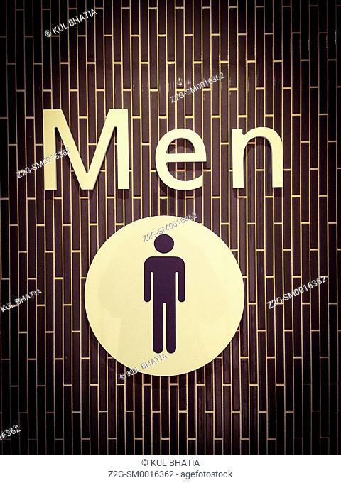 Stylish sign outside Men's toilet, Ontario, Canada