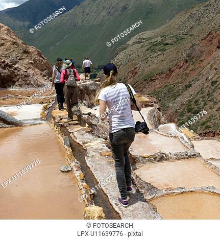 Tourists at a salt mine, Maras, Salinas, Sacred Valley, Cusco Region, Peru
