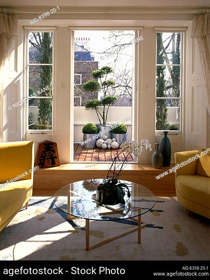Apartment, Hyde Park Street. Designed by Robert Sakula and Canny Ash. Living room looking through to roof terrace