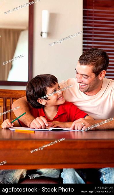 Handsome father helping his son for homework