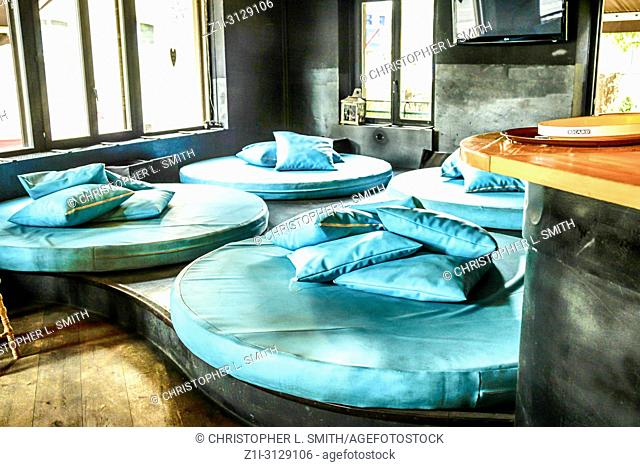 Large round blue matress seating in a Morroccan hippy style cafe in Strasbourg, France