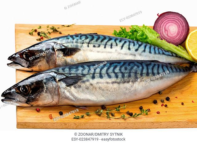 two fresh uncooked mackerel with lemon, onion, spices