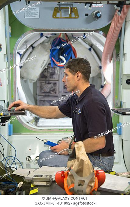 NASA astronaut Michael Hopkins, Expedition 3738 flight engineer, participates in an emergency scenario training session in an International Space Station...