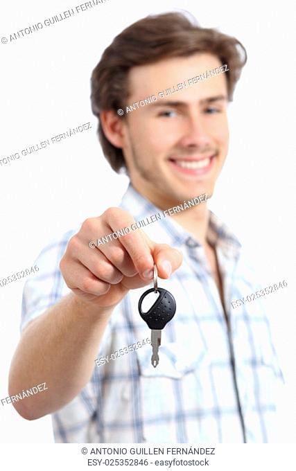 Young man holding a rental car key isolated on a white background