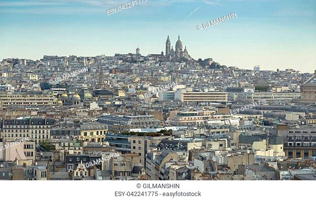 Aerial view of Paris cityscape with Basilica of the Sacred Heart of Paris (Basilique du Sacre Coeur) on Montmartre hill from the top of Triumphal Arch of the...