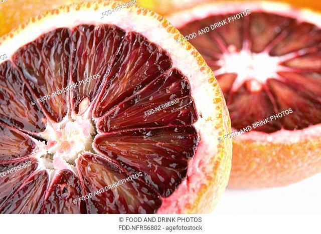 Fresh blood oranges cut in half