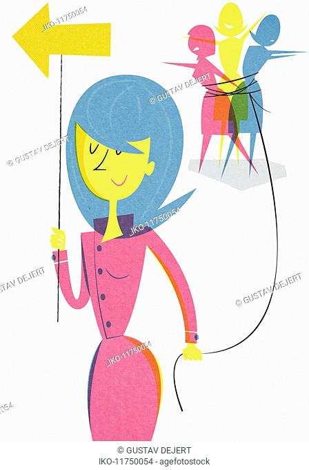 Businesswoman with arrow leading tied women by string