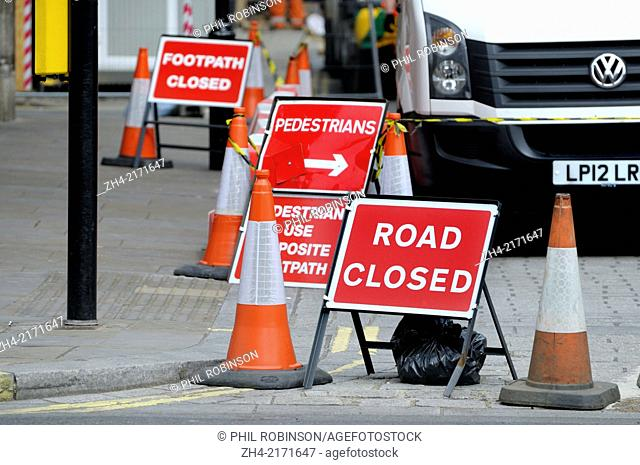 London, England, UK. Collection of traffic signs by roadworks - road closed / footpath closed / pedestrian diversion