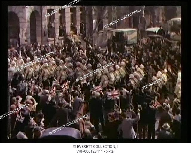 Wide shot British Army marching through street8