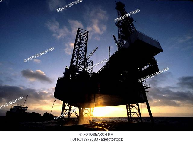 Close-up View of Offshore Oil Drilling Rig at Sunset