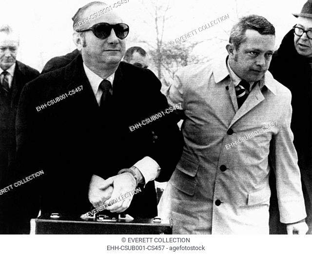Bobby Baker in hand cuffs is escorted by U.S. Marshals into Lewisburg Penitentiary, Jan. 14, 1971. He serving 18 months in prison for fraud, theft