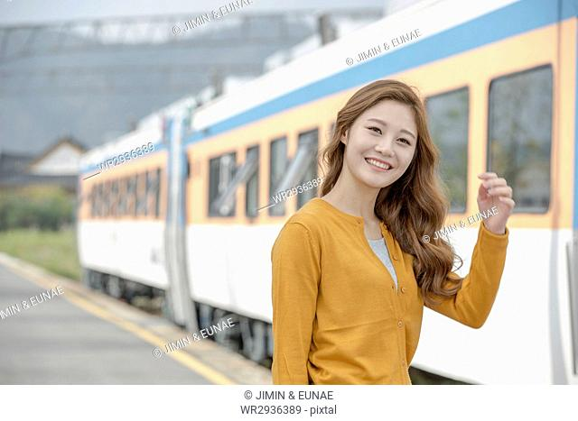 Young smiling woman at station