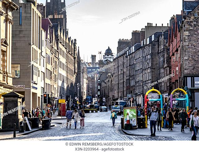 Crowds of people move about the streets of Edinburgh, Scotland, UK
