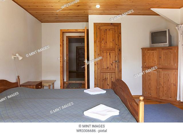 Hotel Bedroom With Wood Ceilings