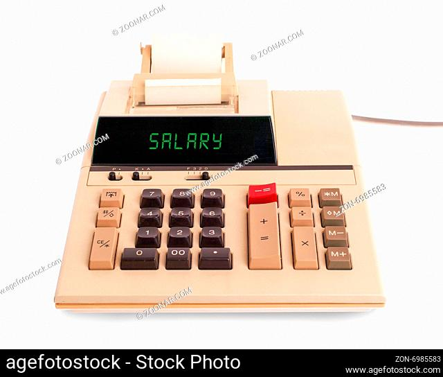 Old calculator showing a text on display - salary