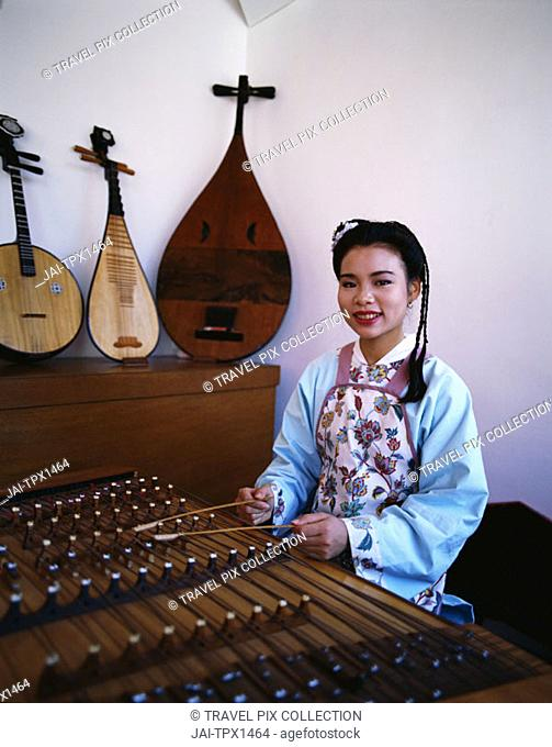 Women Dressed in Traditional Costume Playing Musical Instrument / Zither       , Beijing  , China