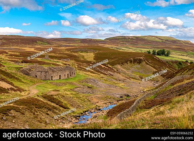 Yorkshire Dales landscape with the ruins of the Surrender Smelt Mill, between Feetham and Langthwaite, North Yorkshire, UK