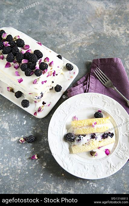 Creamy ice cream with blackberries and rose petals