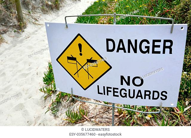 Danger No Lifeguards sign on the beach