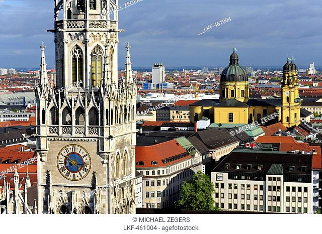 Steeple of the New Town Hall, Neues Rathaus on Marienplatz, with St. Cajetan's church and Theatinerkirche in the background, his