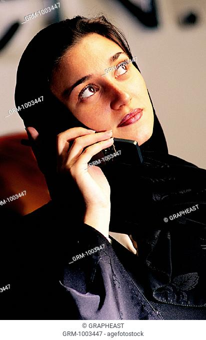 Arab businesswoman using a mobile phone