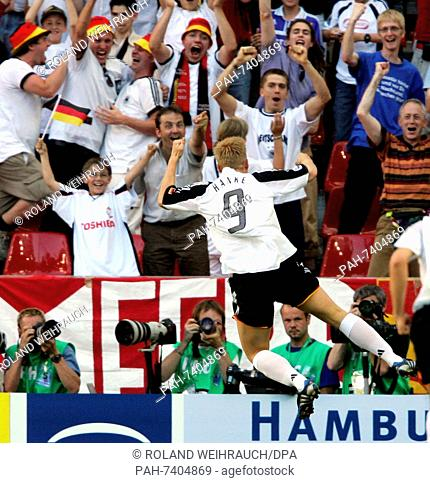 (dpa) - German soccer player Mike Hanke (front) celebrates the third German  goal during the group A match of Confederations Cup tournament Tunisia -  Germany ... 71f094312