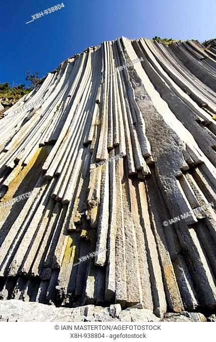 Columnar basalt volcanic rock formations at Stolbchaty Cape on Kunashir Island in Kuril Island chain in Russia