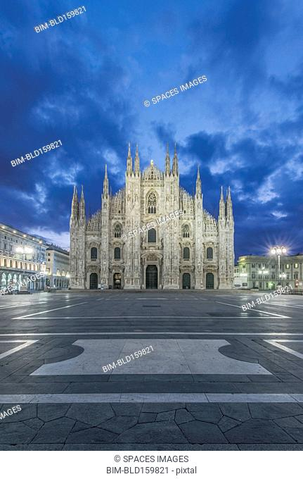 Duomo di Milano cathedral illuminated at night, Milan, Italy