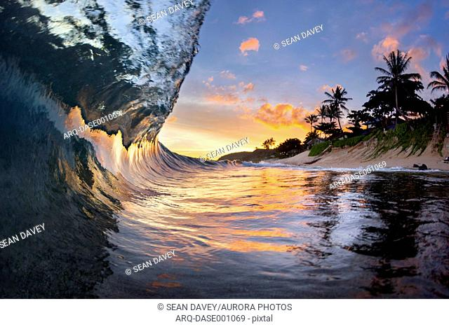 View inside breaking wave at dawn at Sunset Beach, north shore of Oahu, Hawaii Islands, USA