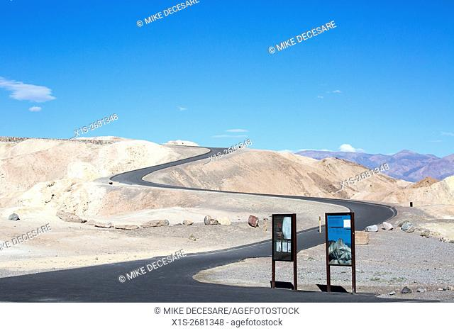 A handicap accessible, paved path takes visitors up a winding slope to a vista at Zabriskie Point in Death Valley
