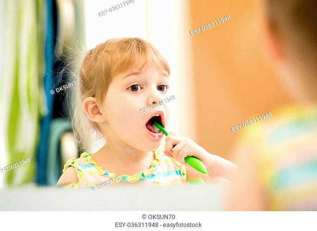 e87d2b6d4b Girl bathrobe brushing teeth Stock Photos and Images