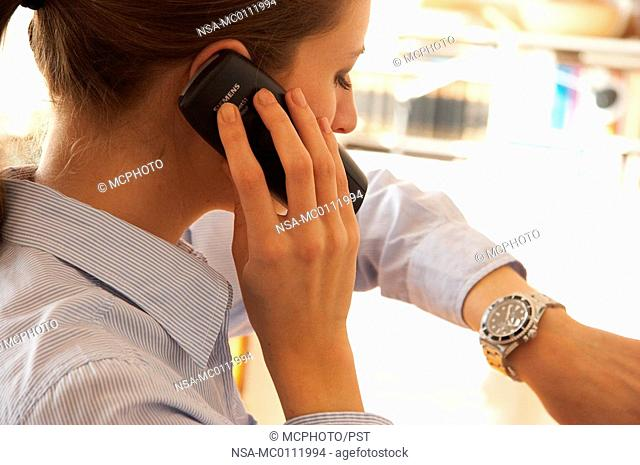 young woman worrying because of her phone bill