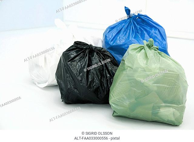 Assortment of garbage bags, all full