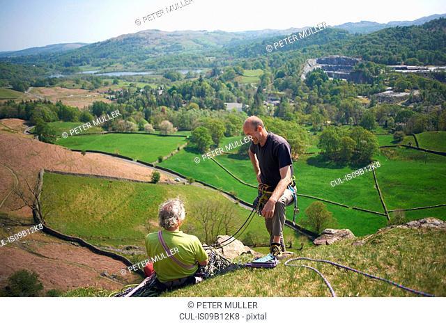 Rock climbers on hillside chatting