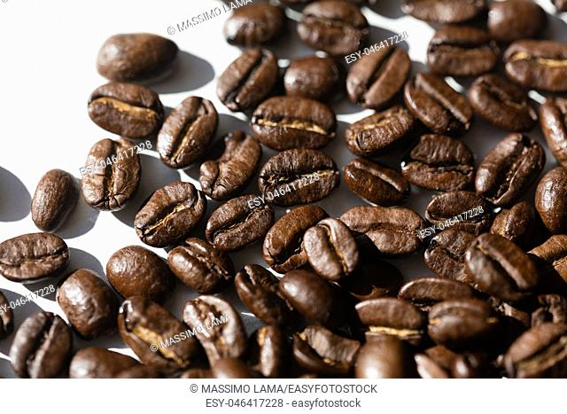 Close up of a group of black coffee grains
