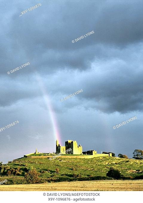 Mediaeval cathedral, round tower and Cormac's Chapel sit on the Rock of Cashel, County Tipperary, Ireland  Sunlit with rainbow