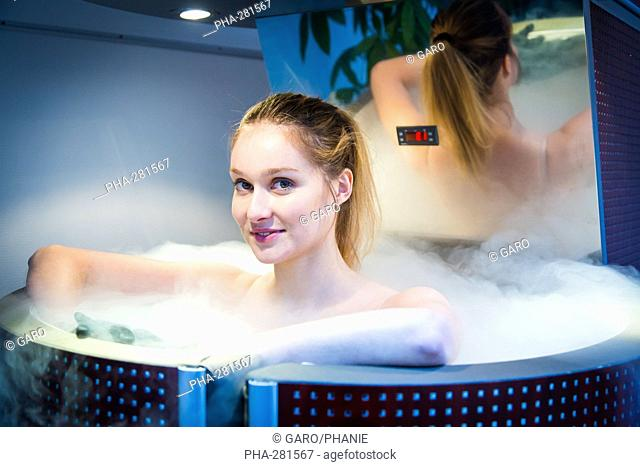 Woman in a whole body cryotherapy cabine