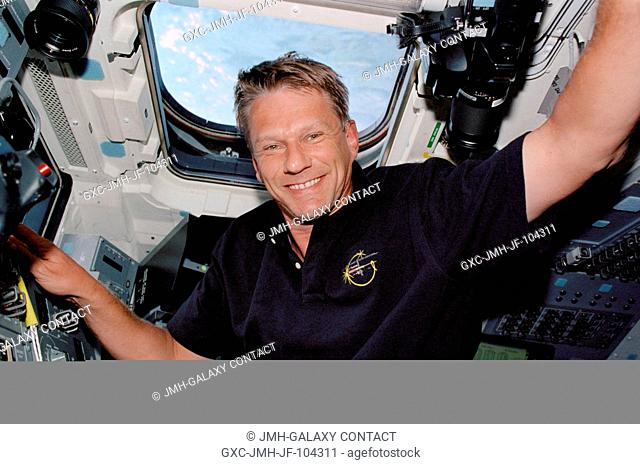 Astronaut Piers J. Sellers, STS-112 mission specialist, is pictured on the aft flight deck of the Space Shuttle Atlantis