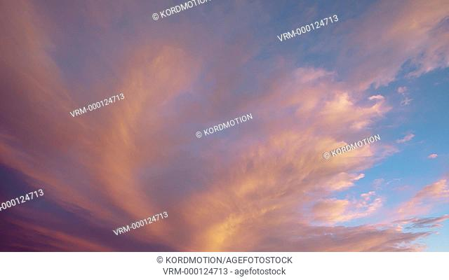 STATIC LOCKED DOWN TIME LAPSE WIDE SHOT HIGH CLOUDS AT SUNSET UNDER CLEAR BLUE SKY