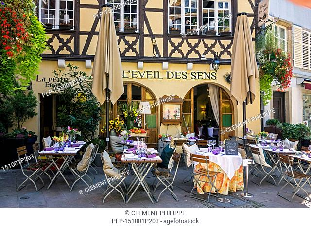 Laid tables outside in front of restaurant L'Eveil des Sens in the city Strasbourg, Alsace, France