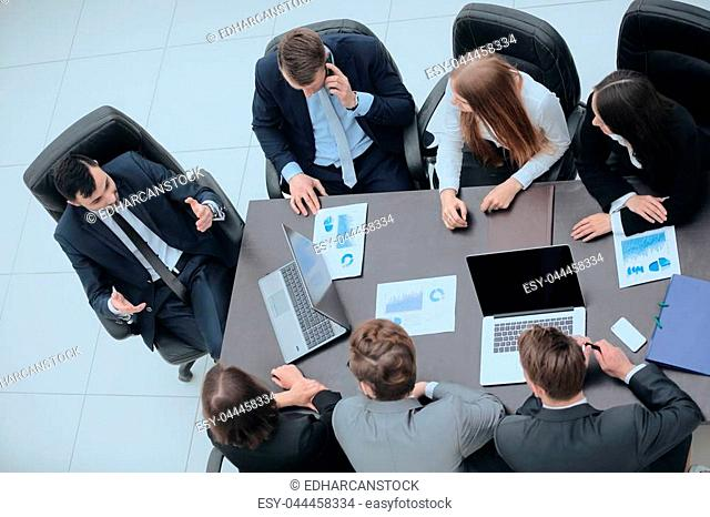 business team at a briefing discussing financial charts