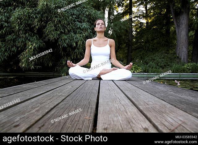 Woman doing yoga in a garden