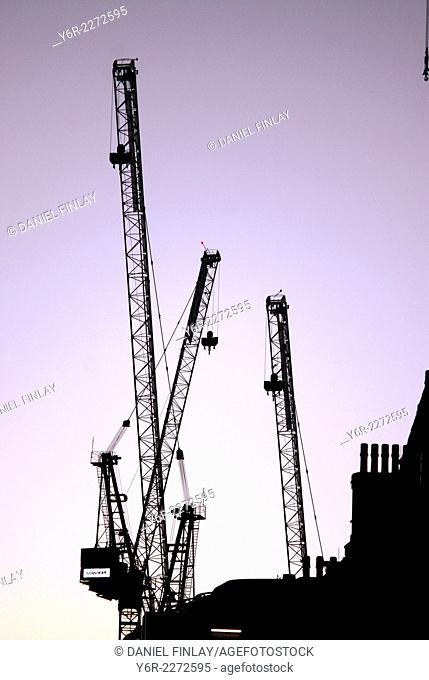 Cranes on the central London skyline at dusk