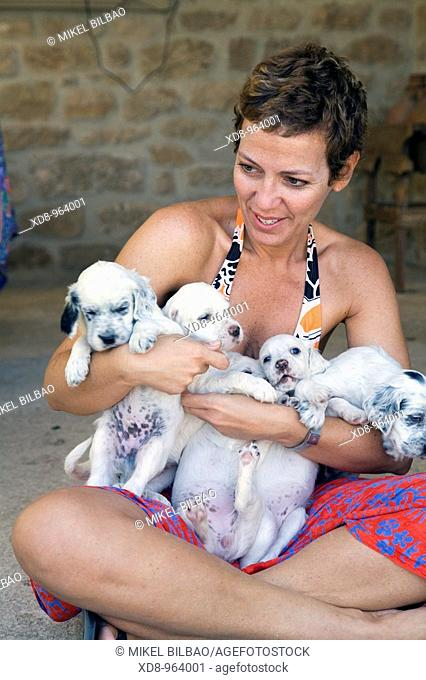 young girl with a dog puppies of the English Setter breed