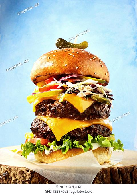 Hero Burger with cheese and gherkins