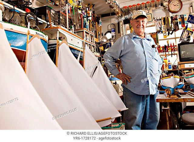 Portrait of Vert Lowe master maker of ship models at his shop on Green Turtle Cay, Bahamas  Master modeler Vert Lowe produces scaled replicas of two-mast...