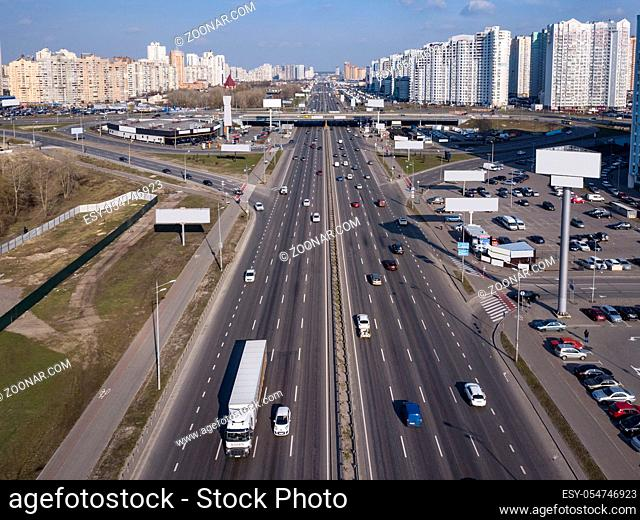 A bird's eye aerial view from drone to the Kharkivskiy district of Kiev, Ukraine with highway, road junction and modern buildings