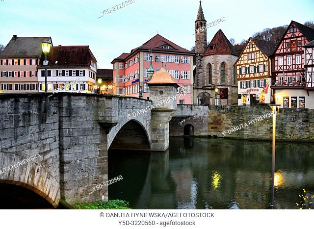 Henkerbrucke - Henker bridge over Kocher river, traditional historic half-timbered townhouses and church Johanniterkirche in background