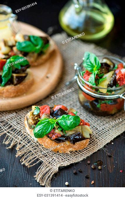 Baked eggplant with tomatoes, garlic on the toast